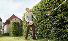 Cordless power systems extended length hedge trimmers