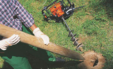 Petrol earth augers and hand held drills