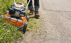Petrol mulching and side discharge lawn mowers